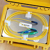 Small fibre launch box for connecting between an OTDR and a cable under test